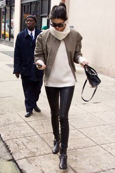 Who: Kendall Jenner What: Leather Leggings Why: The model proves that the timeless edgy item looks consistently current, pairing her J. Brand versions with a Celine sweater and bold-shouldered jacket. Get the look now: J. Brand leggings, $950, jbrandjeans.com   - HarpersBAZAAR.com
