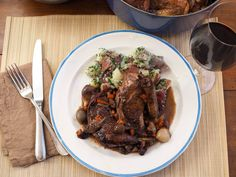 A lot of coq au vin recipes have you braise the bird for hours. That's fine when you're doing it the traditional way with a tough old rooster, but it doesn't work well for the tender roasting hens most of us use today. This recipe delivers a rich and deeply braise with red wine, mushrooms, lardons, and onions that tastes like it was in the oven all day, except that it wasn't.