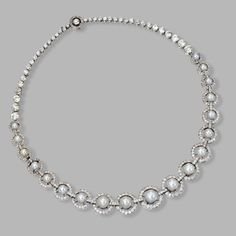 PLATINUM, NATURAL PEARL AND DIAMOND NECKLACE, CIRCA 1935 Of graduated design set at the front with 19 natural pearls measuring approximately 8.71 to 4.68 mm., framed by small single-cut diamonds, completed by collet-set old European-cut diamonds, the total diamond weight approximately 16.50 carats, length 16¾ inches.