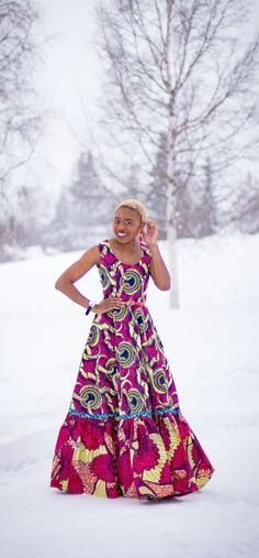 This African wax print maxi dress has me has me oohing and ahhing about ankara styles and summer dresses. Style blogger, Louisa serves major major hotness in this jawdropping ankara dress as part of a 20+ days of African print fashion. The perfect dress to rock to a balmy summer wedding. This outfit from Day 13 of the series is by With Flare Designs. The pops of pink, blue and orange sine beautifully in the background. #africanprint #ankara #ankarafashion #kente