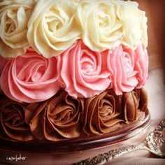 cake decorated pink, brown and ivory roses