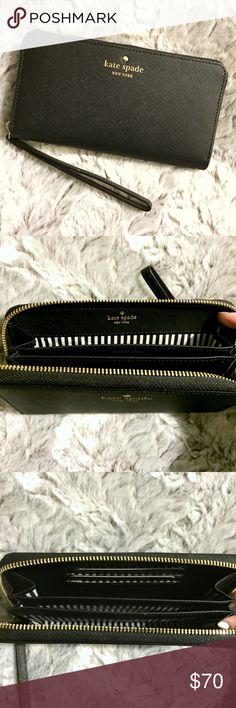 Kate Spade Black Universal Wristlet Large Wallet Brand new WITHOUT tags or box. This Kate Spade Black Universal Wristlet Large Wallet is so beautiful! Gorgeous black saffiano leather with gold hardware & zipper. This wristlet has 3 interior compartments. The middle slot is large enough to fit an iPhone 6 / 6s. The other 2 larger compartments are wide enough to fit receipts & cash. Has 3 slots for credit cards. Classic black & white stripe lining. So convenient when you don't want to carry a…