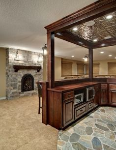 I love the tin ceiling bar and stone floor. Great wet bar for the addition.