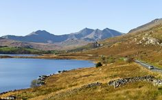 Under threat: The 160ft pylons are planned for areas including the Lake District, Snowdonia (pictured) and parts of rural Wales