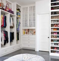 I'm sure all of us WISH our closets were this big and had so much storage and an ottomon... but in reality that is not the case. The best tip for closet organization we've heard is color coordinate. Keep like colors together and even if it's not organized it tricks your eyes into thinking it looks that way!