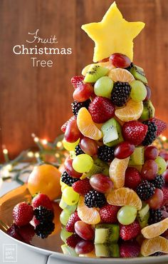 Fruit Platters for Kids: 10 Christmas Party Platters Start a new holiday tradition with a beautiful and fresh Fruit Christmas Tree! Perfect for parties, a dessert table centerpiece, or a healthy treat for Santa Fruit Christmas Tree - Iowa Girl Eats Fruit Christmas Tree, Christmas Party Snacks, Xmas Food, Christmas Desserts, Diy Christmas, Healthy Christmas Treats, Merry Christmas, Christmas Lunch Ideas, Christmas Cooking