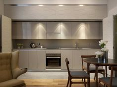 linear kitchens, that close off behind a folding textured wall, are amazing.