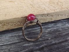 Dark pink jade and silver wire wrapped ring free by Amayeli, $15.00