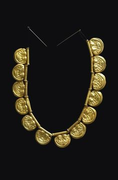 Gold necklace with twenty pendants. 7th century BC