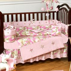 Camo Pink 9 Piece Crib Set by Sweet Jojo Designs:Your little girl may not be quite ready to lead a loyal army into battle, but in the meantime Sweet Jojo Designs' cute Camo Pink collection will keep her safe and comfortable after lights out. This astonishingly affordable package of soft and durable 100% cotton bedding and wonderfully appointed matching accessories creates a cute and cozy nursery worthy of a daughter destined for great things. #timelesstreasure