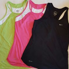 Nike Dri Fit Racer back bundle Both size small. The black on the left has a few small snags in the fabric as seen in the bottom of the last picture. Has a mesh fabric on the sides for air. Nike Tops Tank Tops