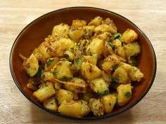 Aloo Jeera (Potatoes with Cumin Seeds) | Manjula's Kitchen | Indian Vegetarian Recipes | Cooking Videos - I like this lady a lot :)