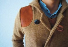 Obviously, the leather on the shoulder is pretty cool, but note the button loop and the sweater underneath the coat.