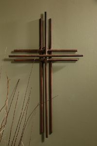 """Three Layered Iron Wall Cross 23.5"""" - Three layers of Iron make up this gorgeously simple wall cross."""