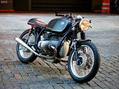 "Bill Costello first made his mark on the world of classic motorcycles when he painstakingly restored his father's 1958 BMW R50. This is his second bike build, an elegant yet functional, R100RT. This time round, Bill wanted to build a custom bike, rather than do a ""factory restoration""—and wanted something he could use as a reliable daily runner."