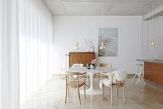 marble floors, midcentury dining table and chairs, sheepskin throws