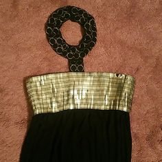 Egyptian looking halter top maxi dress I have an Egyptian inspired halter top maxi dress, black and gold size small.  Some of gold trimming is worn in areas but overall good condition. See picture two, zips in the back. Beautiful and comfortable dress worn only once. Dresses Maxi