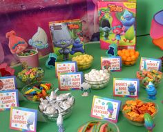 If you are having a Trolls party, what about setting up a Trolls themed snack bar? These fun party food cards are an easy way to do just that and it works well for party food, or a way to allow party guests to fill up a bag with their favorite Trolls treats to take home and enjoy!Below are s