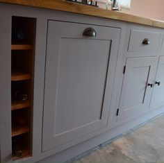 Bespoke, solid wood kitchen finished in Little Greene 'Welcome Dark & Adventurer' with wine rack & solid Oak worktops.
