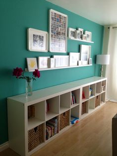 love the bright wall with the row of white bookshelves. This would look great along the tv wall...
