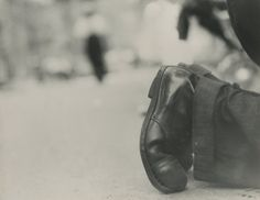 Saul Leiter - Shoes of the Shoeshine Man, c.1951 10 1/2 X 13 3/8 inches Gelatin silver print; printed c.1951