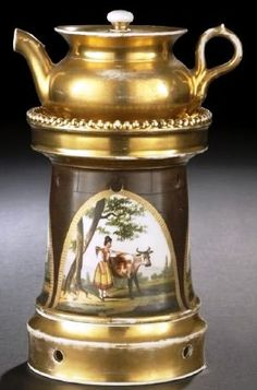 A Paris porcelain~Castellated veilleuse~In three parts Comprised of a gilded base~A turret-form pedestal with three polychrome reserves of cowherds and milkers and a gilded covered teapot~Origin France Circa 1825-1850