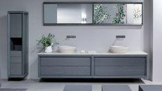 Dogi bathroom by GD Cucine - Baltic grey ash-wood vanity. Honed Biancone stone countertop and washbasin.
