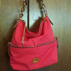 EUC! Red Dooney & Bourke Shoulder Bag In excellent used condition. Red fabric. Leather Shoulder strap and accents in tan color.  Key leash. 2 outside zippered compartments. Inside zippered coin compartment.  Multi slip compartments inside. Always open to reasonable offers!  Please use the offer button below!  Bundle for even greater discounts! Dooney & Bourke  Bags Shoulder Bags