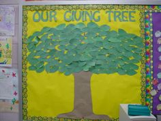 """This tree started out blank. She used it to """"catch kids doing good,"""" but you could also use it for books students have read, ways that students have contributed to/participated in their mainstream classrooms, clever verbs or new words learned, etc.!"""