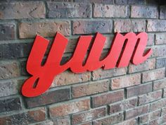 "Wood ""yum"" sign - Large 28 X 10 - Retro Style - Kitchen Decor - Restaurant Decor - Wall Decor - Signage - Painted Red - Distressed - yum. $39.99, via Etsy."