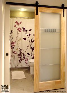 Space saving sliding door.  The center could be a light weight frosted plastic in order for it to not add extra weight to a mobile tiny house while still allowing privacy.