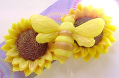 This bumble bee is all over these sunflowers! Inspired by the upcoming summer months, we wanted to create a flower that surely signifies summer! We paired it with our beautiful yellow and brown bumble bee. The set includes two sunflowers and one bumblebee. Scented in honeysuckle; a scent that reminds of me of the street we lived on in Mississippi. The sunflower measures 2.75 in diameter and is about 1 inch in height; weighs 1.7 oz. The bumblebee measures 3 x 2.5 and weighs 0.7 oz. Celebrate…