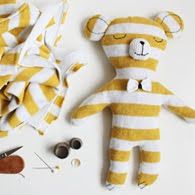 A homemade teddy bear is a great way to use unused fill from a Savvy Rest shredded natural latex pillow. This bear was created using an old t-shirt. Cute!