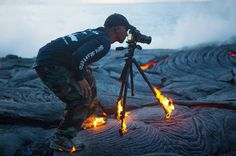 IN THE HEAT OF THE MOMENT Photograph of KAWIKA SINGSON | Taken by Chris Hirata In this crazy capture, we see photographer Kawika Singson getting up close and personal with lava as his shoes and tripod begin to catch fire. The photo went viral after being posted to the highly popular Facebook…