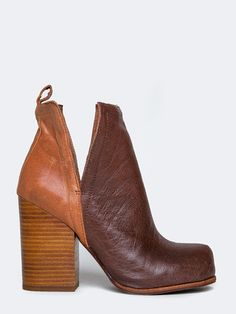 """- Brand: Jeffrey Campbell - Style: Booties - Color: Tan - Material: Leather/Nubuck upper, leather lining, stacked leather sole - Heel Height: 3 1/2"""" - Fits true to size"""