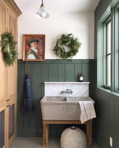 Perfect shade of green paired with marble and natural wood in this utility room