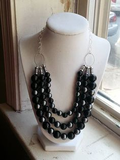 Black glass and grey pearl with silver, triple stranded bib/ statement necklace, fully adjustable on Etsy, $17.00