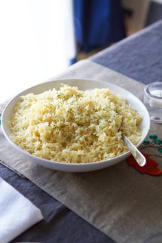 Lauren's Famous Butter Rice: 1/3 cup butter; 1/2 medium yellow onion, finely diced; 1 1/2 cups long grain white rice; 3 cups good quality chicken stock; salt & pepper, to taste; 2-3 bay leaves