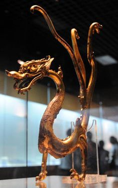Gold-gilded bronze dragon of the Tang Dynasty (618-907).