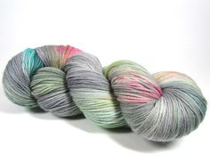 This is a hand dyed hank of Sock or Fingering weight yarn in our Squish Wish base which is composed of 75% Superwash Merino wool and 25% Nylon. The yarn is not only perfect for socks but also great fo