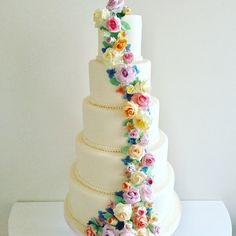 5 Tier Cascading Flower Wedding Cake #sugarflowers #wedding #weddingcake