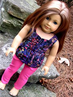 Our American Girl is ready for summer in her super skinny jeans and peplum top. The jeans are made of stretch denim and are super skinny. They feature four pockets and an elastic waist. The top is mad