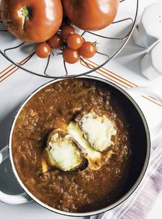 They must use really large serving crocks at Poole's because this recipe for caramelized onion-tomato soup makes way more than six servings, our cookbook reviewer notes.