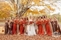 me in white dress bridesmaids in orange dresses and mothers in the light brown dress/pant suit
