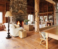"""Melody Duron's restored barn eschews the trappings of """"country cute"""" ... love that the stones were found on the property.  New pine flooring was oiled."""