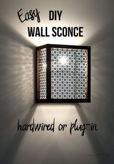 How to make a wall sconce using a simple wood dowel and decorative metallic sheet. This step by step tutorial with video shows you how to add an easy DIY wall sconce to your room. It can be used as an industrial wall sconce shade or a plugin wall sconce. Rustic Wall Sconces, Bathroom Wall Sconces, Modern Wall Sconces, Candle Wall Sconces, Plug In Wall Sconce, Wall Sconce Lighting, Cabin Lighting, Accent Lighting, Traditional Wall Sconces