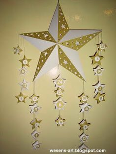 DIY Tutorial: Star Advent Calender: Wesens-Art- Directions and printables to create a unique advent calender. Each little star has a box for  little gift.