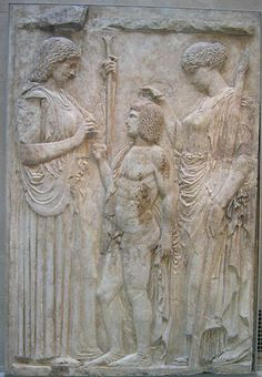 A relief in marble of Demeter handing a stalk of grain to Triptolemus while Persephone places a garland (lost) on his head. Fragments of an Augustan copy set in a plaster cast of the original Greek stele, ca. 450-425 BCE. New York: Metropolitan Museum of Art.