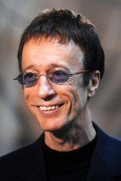 """Robin Gibb, the British pop singer with the quavering falsetto who sold more than 200 million albums with his two brothers in the Bee Gees and became an icon of the """"Saturday Night Fever"""" disco era, has died after a battle with cancer."""