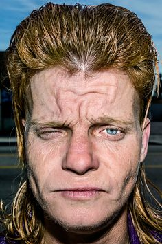 """Bruce Gilden's """"Face"""""""" series (photography book) """"The basis of this project is to show people who are left behind. A lot of these people are invisible and people don't want to look at them and if you don't look at them how can you help them? When you pay attention to those who are usually ignored, it makes their day."""""""